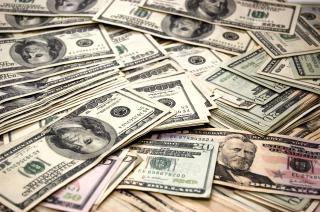 حکایت دلارهای صادراتی که دفن می شوند