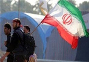 گره خوردن پرچم ایران و عراق در پیاده روی اربعین/ عکس