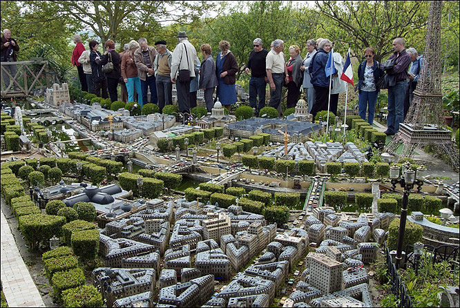Crowds ... people flock to see model of Paris in back garden