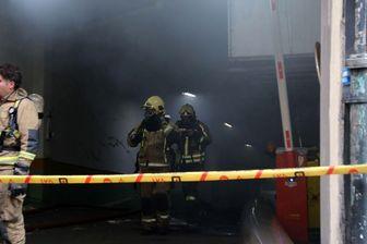 ورود تیم بررسی آتش نشانی به طبقه منفی چهار ساختمان وزارت نیرو