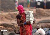 روش عجیب مقابله با گرد و خاک در هند! / عکس